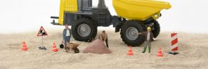 Miniature of workers and equipment hire in construction site