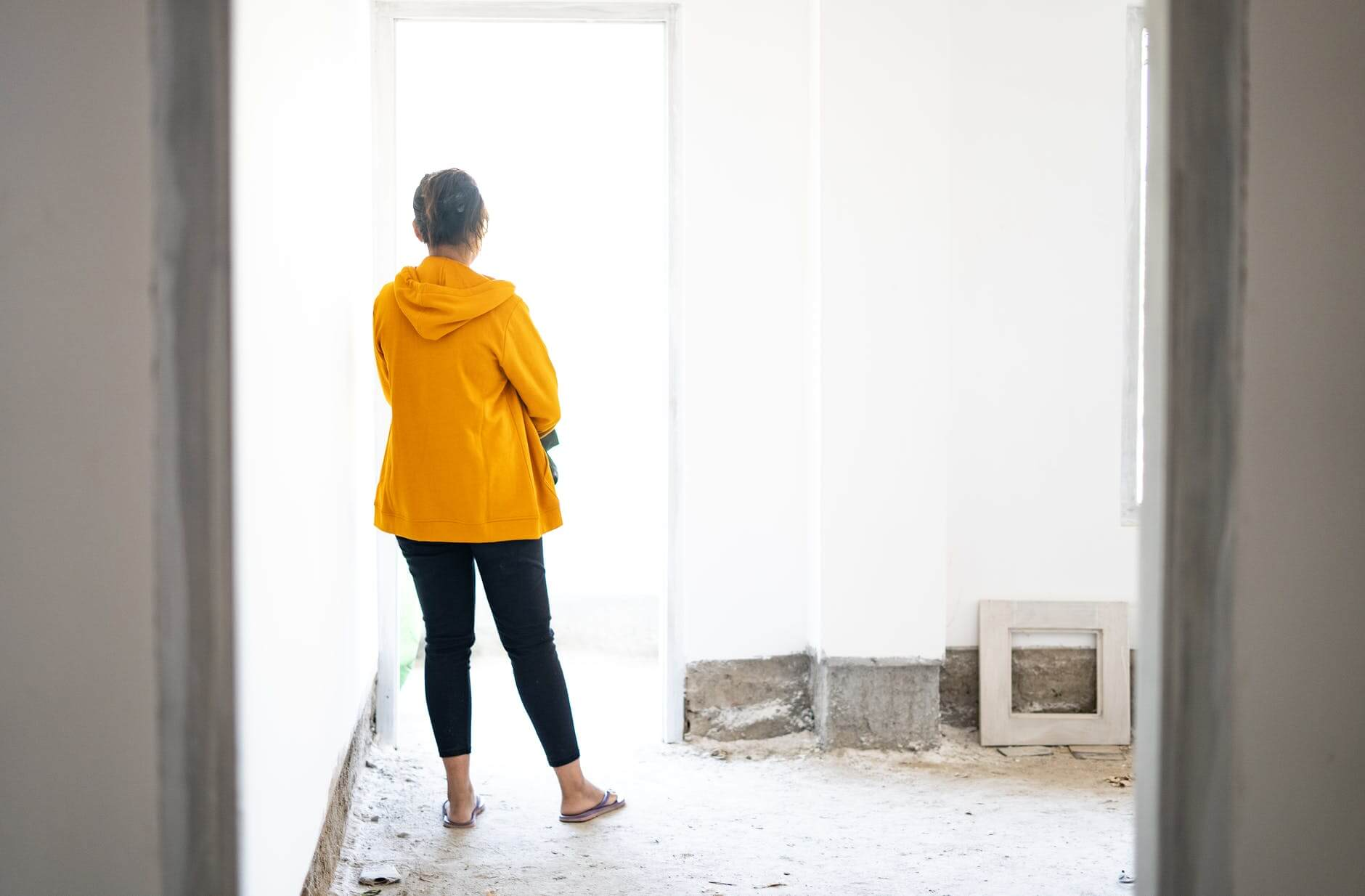 girl inside a house being constructed