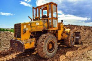an excavator digging dirt